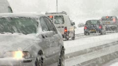 Snow traffic zoom-out Stock Footage