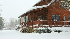 Snowing on a log house (HD)c Stock Footage