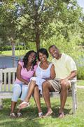 african american family parents & girl child - stock photo