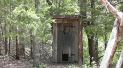 Outhouse in Woods II - stock footage