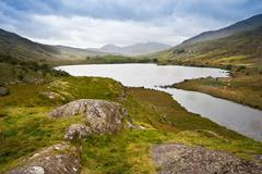 view of snowdon from llyn mymbyr in snowdonia national park - stock photo