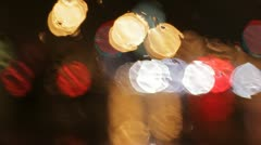 Car window rain night background defocused Stock Footage