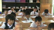 Stock Video Footage of Asian Students Doing School Work In The Classroom