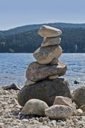 waterside scenery with pebble pile - stock photo