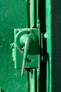Stock Photo of old green door handle and lock