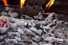 Coal and wood ash from burning in an oven Stock Photos