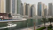 Stock Video Footage of beautyful Dubai Marina Architecture with boat
