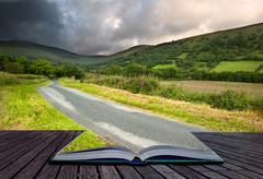 creative concept image of summer landscape in pages of book - stock photo