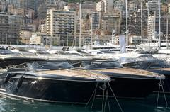 yachts moored in monaco - stock photo