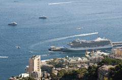 Stock Photo of big cruise ship docked in monaco