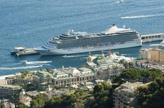 big cruise ship docked in monaco - stock photo