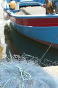 fishing boat and nets - stock photo