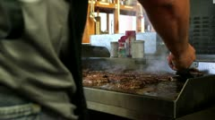 Removing cooked hamburgers from large grill. Stock Footage
