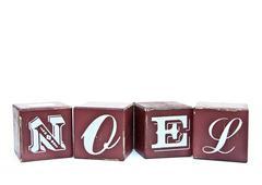 Christmas word noel on wooden blocks isolated on white Stock Photos