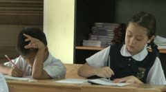 Asian Students Doing School Work In A Classroom - stock footage
