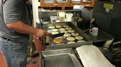 Flipping large amount of chocolate chip pancakes. Stock Footage