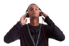 young black man with closed eyes listening to music - stock photo