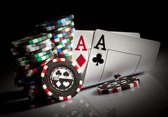 gambling chips and aces - stock photo