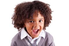 portrait of a cute african little boy screaming - stock photo