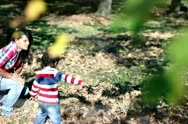 Stock Video Footage of Young mother playing with her son in autumn park, steadycam