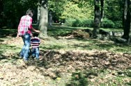 Stock Video Footage of Young mother having fun with her son in beautiful autumn park, slow motion