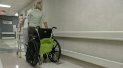 Elderly Aide Walker Hospital Hallway ED Stock Footage
