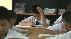 Asian School Boys Doing Work In Their Classroom Stock Footage