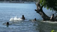 Children plunge into lake water Stock Footage