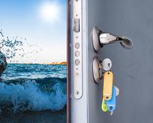 Open door with a sea view Stock Photos