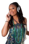 pretty young black girl listening music - stock photo