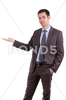 Stock photo of portrait of a young caucasian business man holding something