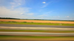 Car driving through countryside on the highway - stock footage