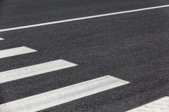 crosswalk on asphalt - stock photo