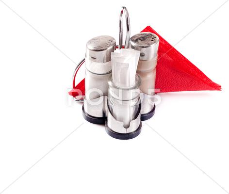 Stock photo of saltcellar, pepperbox and napkins