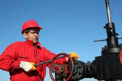 Oil Rig Valve Technician at Work - stock photo