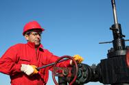 Stock Photo of Oil Rig Valve Technician at Work