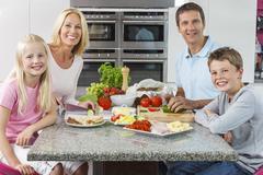 Parents children family preparing healthy food Stock Photos
