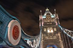 tower bridge architectural detail at night - london - stock photo