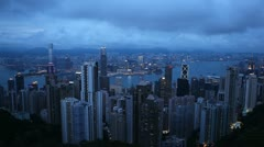 Dusk Aerial View of Hong Kong Island Skyline, Victoria Harbour, Kowloon Twilight - stock footage