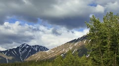 Windy Stormclouds over Alaskan Mountains with Tree 30p Stock Footage