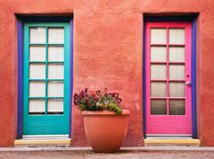 Colorful doors and terracotta wall - stock photo
