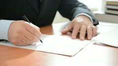 Businessman writing notes in a documents. Full HD Stock Footage