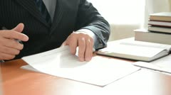 Stock Video Footage of Boss signing a documents. Full HD
