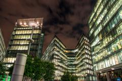 london modern buildings illuminated at night - stock photo