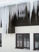 Stock Photo of icicles in front of a house facade