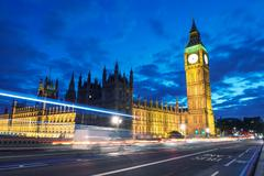 palace of westminster with big ben seen from westminster bridge at night - lo - stock photo