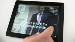 Reading news of Flipboard on a touch screen tablet pc - stock footage