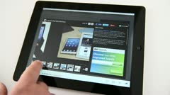 Reading review of iPad mini on a touch screen tablet pc Stock Footage