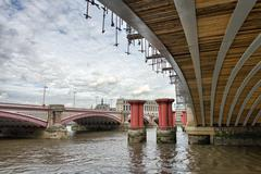 structure and architecture of london bridges - uk - stock photo