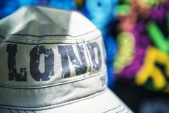 gray hat in camden town market - london - stock photo